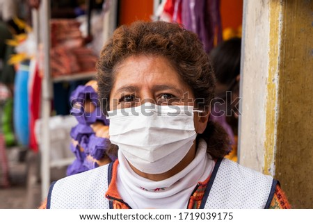 Woman in repiratory mask during coronavirus pandemic in market in Cusco, Peru in Latin South America. Epidemic of coronavirus covid-19 #1719039175