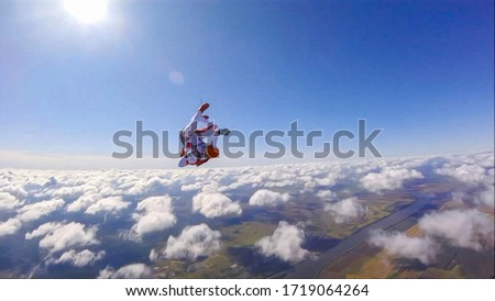 Adrenaline. Extreme sky for free people. No rules in open air. Parachutist in professional suit is in free fall. Skydiving is a sport of the future.    #1719064264