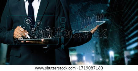 Double exposure of two businessman working on digital tablet and smart phone with digital marketing virtual chart, Abstract icon, Business strategy concept.