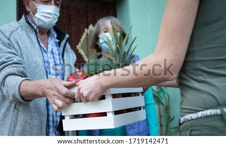 COVID-19 Stay home. Delivering grocery supply for elderly. #1719142471