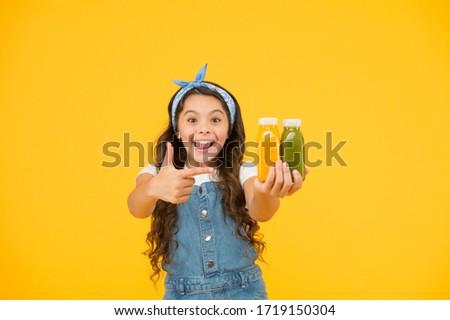 Supermarket promotion. Living healthy life. Vitamin juice. Fresh smoothie. Girl drinking orange fresh smoothie. Vegetarian concept. Smiling kid hold fruit smoothie bottles. Healthy food. Buy food. #1719150304