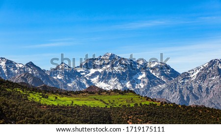 Morocco  High Atlas Mountain range. Morocco  High Atlas Mountain range. Springtime. Blue sky. Bright sunshine.  Royalty-Free Stock Photo #1719175111
