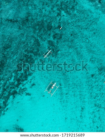 Close Up Drone Shot of 2 Boats on Beautiful Aqua Colored Water at Suluban Surfer's Beach Bali A.K.A Blue Point Beach Bali #1719215689
