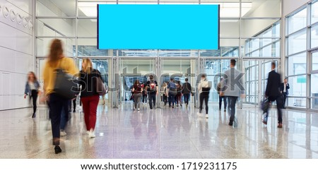 Blank billboard in progress of a trade fair or event over many people Royalty-Free Stock Photo #1719231175