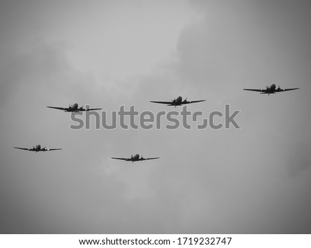 D-Day celebrations with parachutists and Dakotas above Europe, France, Belgium and the Netherlands. Anniversary of the battle of Normandy. (DDay, D'Day, World War II or Second World War). Royalty-Free Stock Photo #1719232747