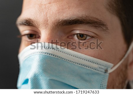 Coronavirus. Close up face doctor. Thank you doctors and nurses working in the hospitals and fighting the coronavirus. Doctors are heroes. Doctor with mask looking for a cure to corona virus fight.  #1719247633