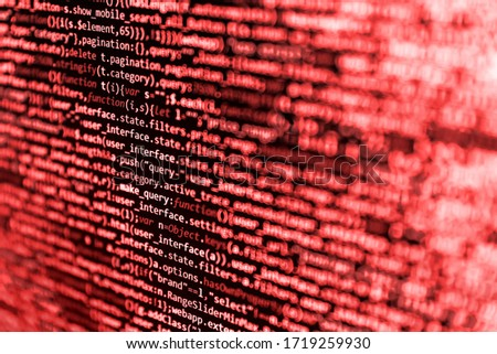 IT coding on monitor screen. Abstract technology background. Website development. Screen of code for overlay background. Programming, webdesign HTML printed code. Mobile app developer