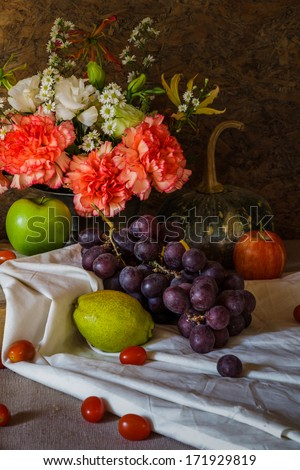 Still life with fruit There are many kinds, apples, grapes, pears, pumpkins and consists of flower vases. Beautifully arranged together #171929819