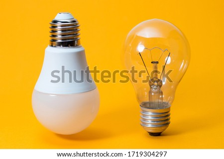 Light bulbs. isolated of Incandescent bulbs, fluorescent bulbs, orange old generation bulb, Tungsten bulb, and white energy saving bulb #1719304297
