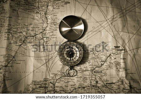 Compass on the map black and white #1719355057