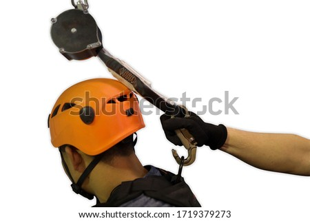 Worker hand wearing black glove clipping an inertia reel hook onto abseiler fall arrest body harness together attached on lanyard shock absorber device isolated dropped shadow white background   #1719379273