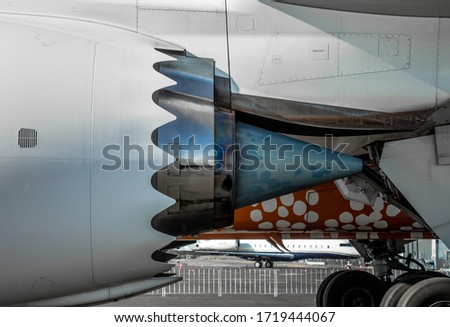 Close up photo of a turbofan engine exhaust, showing details of it's chevron  on the exhaust cowling