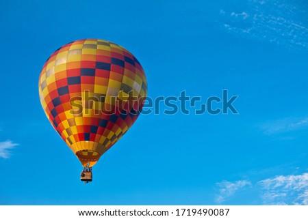 Hot air balloon in a blue sky #1719490087