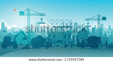 Workers building houses with cranes on construction sites. Royalty-Free Stock Photo #1719497389
