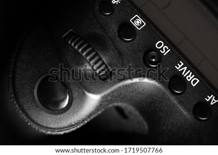 iso button on a camera shot on a black background. drive button