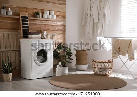 Stylish room interior with washing machine. Design idea #1719510001