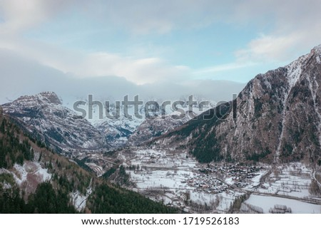 The village Palleusieux under a big mountain, in the Basin Pre-Saint-Didier, Aosta Valley at the time of corona virus outbreak, northern Italy #1719526183