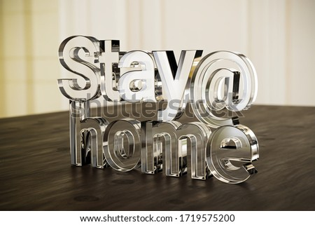Stay at home: A textblock made from acrylic glass on a living room table. Selective focus.