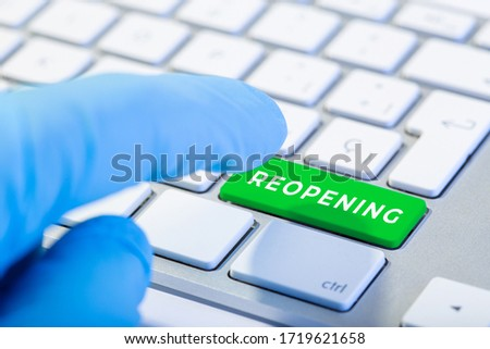 Reopening concept after the coronavirus pandemic. Hand ready to push Keyboard with green key and text #1719621658