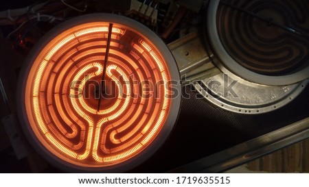close up of kitchen stove burner inside electrical resistance thermostat cooking food technology wire cables fire electricity heat power ac ceramic induction hob repair technician recipe chef #1719635515