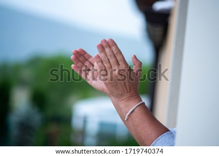 Hands of middle-aged women applaud the toilets in the window for the effort before the covid-19 #1719740374