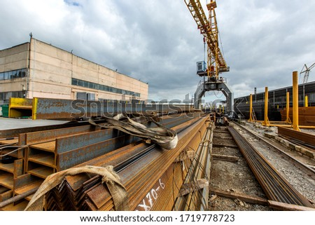 industrial building and construction crane in front of it #1719778723