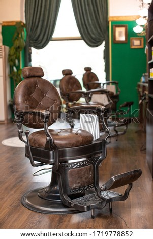 luxury armchairs in barber shop #1719778852