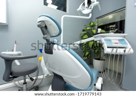 dental cabinet with various medical equipment #1719779143