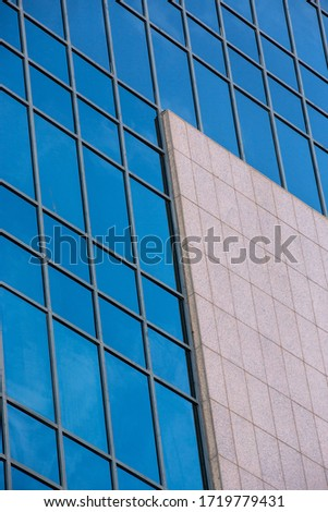 office building with blue panorama windows #1719779431