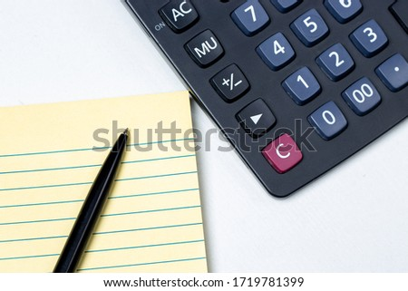yellow notepad with white pen on it #1719781399