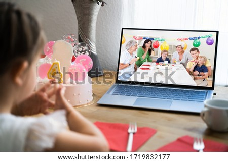 Family Celebrating Birthday Using Video Conference Call #1719832177