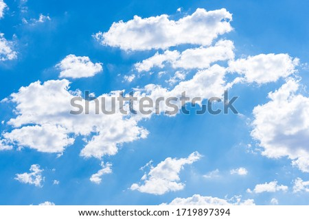 Blue sky background with clouds Royalty-Free Stock Photo #1719897394