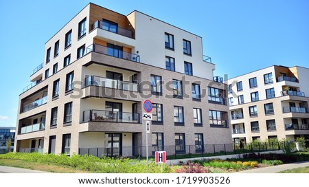 Warsaw, Poland. 27 April 2020. Modern apartment building in Wilanow district on a sunny day with a blue sky. Facade of a modern apartment. #1719903526