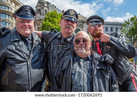 Birmingham, UK - May 25, 2019 - Guys dressed in full leather outfits share a smile in Victoria Square prior to taking part in the Pride parade. #1720062691