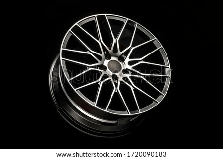 black alloy wheels, aluminum disc sport with a carbon fiber cover. Light weight and modern cool design Royalty-Free Stock Photo #1720090183