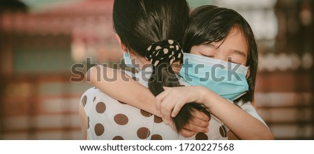Cute child daughter hugging mother on blurred home background, kids school back to home on mather's day, Asian children and mother wearing mask protect coronavirus 19 and pm 2.5 particle in air #1720227568