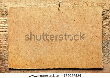 Cardboard nailed to wooden wall #172029524