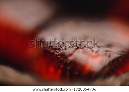 Hot coal close-up. The texture of the burning cube of coal.Cracked ash macro shot. Horizontal photo. #1720354936