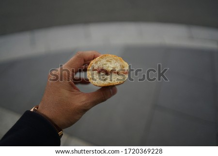 Man hand holding the eaten sandwich with blur background #1720369228
