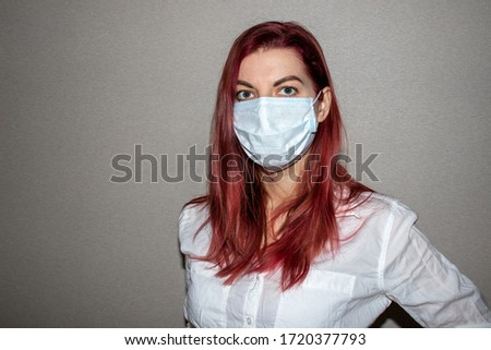 Young girl in a mask. Prophylactic agents against coronavirus. Health concept. Epidemic coronavirus 2019-nCoV. #1720377793