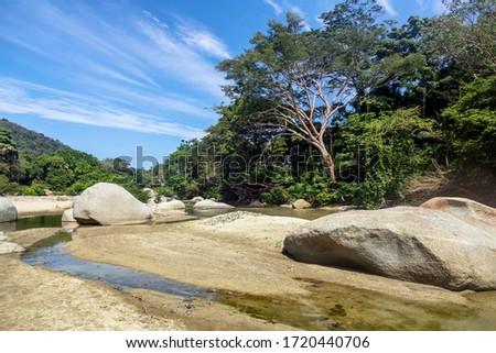 Palomino - Colombia, 20. January 2020: Nice stones in the Quebrada Concha river next to Tayrona National Park between Palomino und Santa Marta, Colombia #1720440706