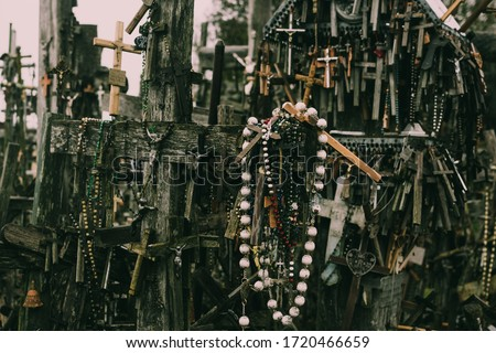 Numerous wooden and metal crucifixes on the hill of crosses