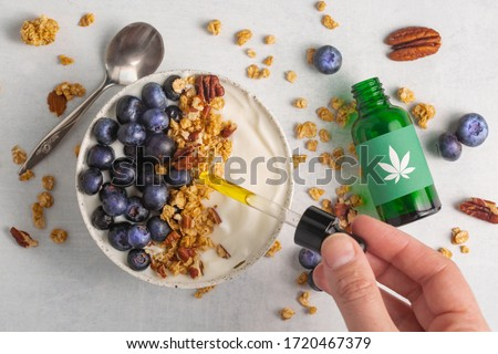 Cannabis infused granola, blueberry and greek yogurt. CBD smoothie bowl recipe for the chillest summer breakfast. Start your morning wth a few drops of CBD oil for a health and wellness kick start.