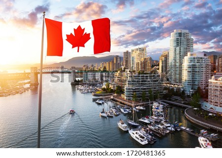 Canadian National Flag Overlay. False Creek, Downtown Vancouver, British Columbia, Canada. Beautiful Aerial View of a Modern City on the West Pacific Coast during a colorful Sunset. Royalty-Free Stock Photo #1720481365