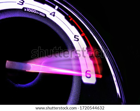 Close up shot of a speedometer in a car. At an engine speed of 6000 rpm on Car dashboard.Car Interior ilumination. Royalty-Free Stock Photo #1720544632