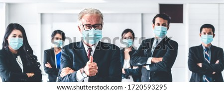 Confident business people with face mask protect from Coronavirus or COVID-19. Concept of help, support and collaboration together to overcome epidemic of Coronavirus or COVID-19 to reopen business. #1720593295