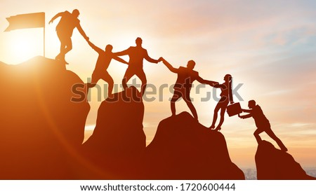 Concept of teamwork with team climbing mountain top Royalty-Free Stock Photo #1720600444