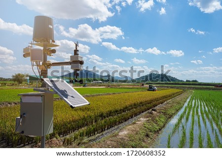 Agriculture technology, artificial intelligence (AI) concepts, Smart farmer use smart farm wireless control agricultural machinery replace worker and increase precision. Royalty-Free Stock Photo #1720608352