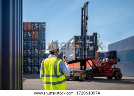 Foreman control loading Containers box to truck for Logistic Import Export Background, Business logistic concept, import and export concept #1720610074