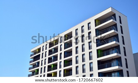 New contemporary residential building exterior in the daylight. Modern apartment buildings on a sunny day with a blue sky. Facade of a modern apartment building Royalty-Free Stock Photo #1720667602